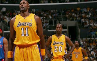 LOS ANGELES - JUNE 8: Karl Malone #11, Gary Payton #20 and Kobe Bryant #8 of the Los Angeles Lakers looks on in Game two of the 2004 NBA Finals against the Detroit Pistons   June 8, 2004 at Staples Center in Los Angeles, California.  NOTE TO USER: User expressly acknowledges and agrees that, by downloading and or using this photograph, User is consenting to the terms and conditions of the Getty Images License Agreement.  Mandatory Copyright Notice: Copyright 2004 NBAE  (Photo by Jesse D. Garrabrant/NBAE via Getty Images)
