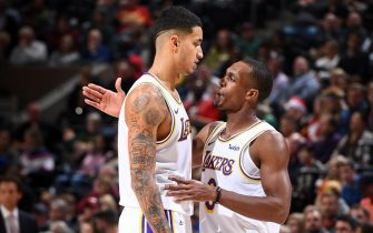 SALT LAKE CITY, UT - DECEMBER 4: Kyle Kuzma #0 of the Los Angeles Lakers shares a conversation with teammate, Rajon Rondo #9 during the game against the Utah Jazz on December 4, 2019 at vivint.SmartHome Arena in Salt Lake City, Utah. NOTE TO USER: User expressly acknowledges and agrees that, by downloading and or using this Photograph, User is consenting to the terms and conditions of the Getty Images License Agreement. Mandatory Copyright Notice: Copyright 2019 NBAE (Photo by Garrett Ellwood/NBAE via Getty Images)
