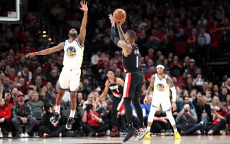 PORTLAND, OREGON - JANUARY 20: Damian Lillard #0 of the Portland Trail Blazers takes a shot against Alec Burks #8 of the Golden State Warriors in the fourth quarter at Moda Center on January 20, 2020 in Portland, Oregon. NOTE TO USER: User expressly acknowledges and agrees that, by downloading and or using this photograph, User is consenting to the terms and conditions of the Getty Images License Agreement (Photo by Abbie Parr/Getty Images)  (Photo by Abbie Parr/Getty Images)