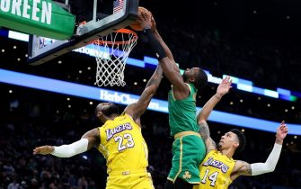 BOSTON, MASSACHUSETTS - JANUARY 20: Jaylen Brown #7 of the Boston Celtics dunks over LeBron James #23 and Danny Green #14 of the Los Angeles Lakers at TD Garden on January 20, 2020 in Boston, Massachusetts. The Celtics defeat the Lakers 139-107.  (Photo by Maddie Meyer/Getty Images)