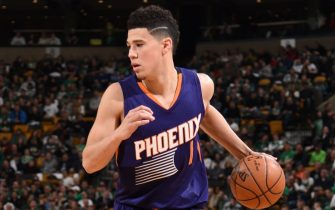 BOSTON, MA - MARCH 24:  Devin Booker #1 of the Phoenix Suns handles the ball against the Boston Celtics on March 24, 2017 at the TD Garden in Boston, Massachusetts.  NOTE TO USER: User expressly acknowledges and agrees that, by downloading and or using this photograph, User is consenting to the terms and conditions of the Getty Images License Agreement. Mandatory Copyright Notice: Copyright 2017 NBAE  (Photo by Brian Babineau/NBAE via Getty Images)