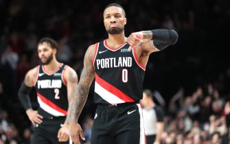 PORTLAND, OREGON - JANUARY 20: Damian Lillard #0 of the Portland Trail Blazers celebrates after making a three-point basket in the fourth quarter against the Golden State Warriors at Moda Center on January 20, 2020 in Portland, Oregon. NOTE TO USER: User expressly acknowledges and agrees that, by downloading and or using this photograph, User is consenting to the terms and conditions of the Getty Images License Agreement (Photo by Abbie Parr/Getty Images)  (Photo by Abbie Parr/Getty Images)