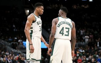 MILWAUKEE, WISCONSIN - OCTOBER 09:  Giannis Antetokounmpo #34 and Thanasis Antetokounmpo #43 of the Milwaukee Bucks meet in the second quarter against the Utah Jazz during a preseason game at Fiserv Forum on October 09, 2019 in Milwaukee, Wisconsin. NOTE TO USER: User expressly acknowledges and agrees that, by downloading and or using this photograph, User is consenting to the terms and conditions of the Getty Images License Agreement. (Photo by Dylan Buell/Getty Images)