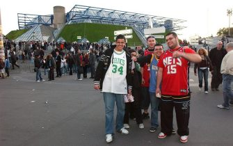PARIS - OCTOBER 9: NBA fans display their team loyalties outside the Bercy Arena, prior to the start of a preseason game between the New Jersey Nets and the Miami Heat as part of the 2008 NBA Europe Live Tour on October 9, 2008 in Paris, France. NOTE TO USER: User expressly acknowledges and agrees that, by downloading and/or using this photograph, user is consenting to the terms and conditions of the Getty Images License Agreement.  Mandatory Copyright Notice: Copyright 2008 NBAE (Photo by Randy Belice/NBAE via Getty Images)
