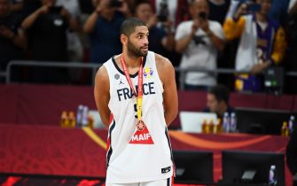 BEIJING, CHINA - SEPTEMBER 15: Nicolas Batum #5 of France receives his medal after the 2019 FIBA World Cup Third Place Game against France at the Cadillac Arena on September 15, 2019 in Beijing, China. NOTE TO USER: User expressly acknowledges and agrees that, by downloading and/or using this Photograph, user is consenting to the terms and conditions of the Getty Images License Agreement. Mandatory Copyright Notice: Copyright 2019 NBAE (Photo by Garrett W. Ellwood/NBAE via Getty Images)