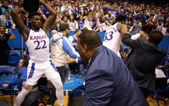 LAWRENCE, KANSAS - JANUARY 21:  Silvio De Sousa #22 of the Kansas Jayhawks picks up a chair during a brawl as the game against the Kansas State Wildcats ends at Allen Fieldhouse on January 21, 2020 in Lawrence, Kansas. (Photo by Jamie Squire/Getty Images)