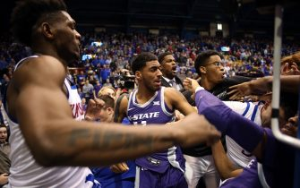 LAWRENCE, KANSAS - JANUARY 21:  Antonio Gordon #11 of the Kansas State Wildcats grabs Elijah Elliott #5 of the Kansas Jayhawks while Silvio De Sousa #22 of the Kansas Jayhawks pushes David Sloan #4 of the Kansas State Wildcats during a brawl after the game at Allen Fieldhouse on January 21, 2020 in Lawrence, Kansas. (Photo by Jamie Squire/Getty Images)
