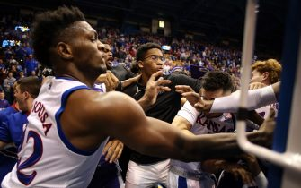 LAWRENCE, KANSAS - JANUARY 21:  James Love III of the Kansas State Wildcats grabs Elijah Elliott #5 of the Kansas Jayhawks while Silvio De Sousa #22 of the Kansas Jayhawks pushes David Sloan #4 of the Kansas State Wildcats during a brawl after the game at Allen Fieldhouse on January 21, 2020 in Lawrence, Kansas. (Photo by Jamie Squire/Getty Images)