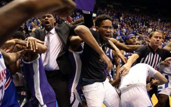 LAWRENCE, KANSAS - JANUARY 21:  James Love III of the Kansas State Wildcats grabs Elijah Elliott #5 of the Kansas Jayhawks during a brawl after the game at Allen Fieldhouse on January 21, 2020 in Lawrence, Kansas. (Photo by Jamie Squire/Getty Images)