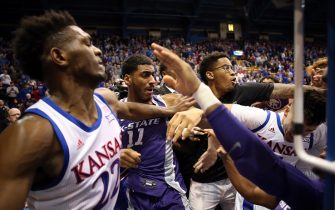LAWRENCE, KANSAS - JANUARY 21:  James Love III of the Kansas State Wildcats grabs Elijah Elliott #5 of the Kansas Jayhawks and Silvio De Sousa #22 of the Kansas Jayhawks pushes Antonio Gordon #11 of the Kansas State Wildcats during a brawl after the game at Allen Fieldhouse on January 21, 2020 in Lawrence, Kansas. (Photo by Jamie Squire/Getty Images)