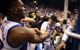 LAWRENCE, KANSAS - JANUARY 21:  James Love III of the Kansas State Wildcats grabs Elijah Elliott #5 of the Kansas Jayhawks and Silvio De Sousa #22 during a brawl after the game at Allen Fieldhouse on January 21, 2020 in Lawrence, Kansas. (Photo by Jamie Squire/Getty Images)