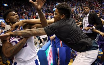 LAWRENCE, KANSAS - JANUARY 21:  Silvio De Sousa #22 of the Kansas Jayhawks and James Love III of the Kansas State Wildcats exchange blows during a brawl after the game at Allen Fieldhouse on January 21, 2020 in Lawrence, Kansas. (Photo by Jamie Squire/Getty Images)