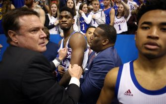 LAWRENCE, KANSAS - JANUARY 21:  Head coach Bill Self of the Kansas Jayhawks holds back Silvio De Sousa #22 of the Kansas Jayhawks during a brawl as the game against the Kansas State Wildcats ends at Allen Fieldhouse on January 21, 2020 in Lawrence, Kansas. (Photo by Jamie Squire/Getty Images)