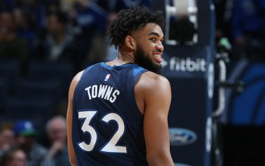 MINNEAPOLIS, MN - DECEMBER 11: Karl-Anthony Towns #32 of the Minnesota Timberwolves looks on against the Utah Jazz on December 11, 2019 at Target Center in Minneapolis, Minnesota. NOTE TO USER: User expressly acknowledges and agrees that, by downloading and or using this Photograph, user is consenting to the terms and conditions of the Getty Images License Agreement. Mandatory Copyright Notice: Copyright 2019 NBAE (Photo by David Sherman/NBAE via Getty Images)