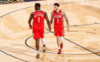 NEW ORLEANS, LA - JANUARY 22: Zion Williamson #1, and Lonzo Ball #2 of the New Orleans Pelicans hi-five each other during the game against the San Antonio Spurs on January 22, 2020 at Smoothie King Center in New Orleans, Louisiana. NOTE TO USER: User expressly acknowledges and agrees that, by downloading and or using this photograph, User is consenting to the terms and conditions of the Getty Images License Agreement. Mandatory Copyright Notice: Copyright 2020 NBAE (Photo by Jeff Haynes/NBAE via Getty Images)