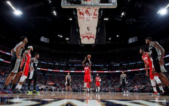 NEW ORLEANS, LA - JANUARY 22: Zion Williamson #1 of the New Orleans Pelicans shoots a free throw against the San Antonio Spurs on January 22, 2020 at Smoothie King Center in New Orleans, Louisiana. NOTE TO USER: User expressly acknowledges and agrees that, by downloading and or using this photograph, User is consenting to the terms and conditions of the Getty Images License Agreement. Mandatory Copyright Notice: Copyright 2020 NBAE (Photo by Jeff Haynes/NBAE via Getty Images)