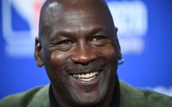 Former NBA star and owner of Charlotte Hornets team Michael Jordan looks on as he addresses a press conference ahead of the NBA basketball match between Milwakuee Bucks and Charlotte Hornets at The AccorHotels Arena in Paris on January 24, 2020. (Photo by FRANCK FIFE / AFP) (Photo by FRANCK FIFE/AFP via Getty Images)