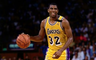 LOS ANGELES - 1989: Magic Johnson #32 of the Los Angeles Lakers moves the ball upcourt during an NBA game at the Forum in Los Angeles, California. NOTE TO USER: User expressly acknowledges  and agrees that, by downloading and or using this  photograph, User is consenting to the terms and conditions of the Getty Images License Agreement. (Photo by Andrew D. Bernstein/ NBAE/ Getty Images)