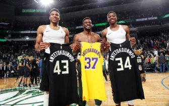 MILWAUKEE, WI - DECEMBER 19: Giannis Antetokounmpo #34 of the Milwaukee Bucks, Thanasis Antetokounmpo #43 of the Milwaukee Bucks, and Kostas Antetokounmpo #37 of the Los Angeles Lakers exchange jerseys after a game on December 19, 2019 at the Fiserv Forum Center in Milwaukee, Wisconsin. NOTE TO USER: User expressly acknowledges and agrees that, by downloading and or using this Photograph, user is consenting to the terms and conditions of the Getty Images License Agreement. Mandatory Copyright Notice: Copyright 2019 NBAE (Photo by Joe Murphy/NBAE via Getty Images).