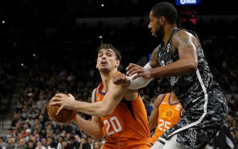 SAN ANTONIO, TX - JANUARY 24: Dario Saric #20 of the Phoenix Suns looks for room around LaMarcus Aldridge #12 of the San Antonio Spurs during an NBA game at the AT&T Center on January 24, 2020 in San Antonio, Texas. The Suns won 103-99.  NOTE TO USER: User expressly acknowledges and agrees that, by downloading and or using this photograph, User is consenting to the terms and conditions of the Getty Images License Agreement.  (Photo by Edward A. Ornelas/Getty Images)
