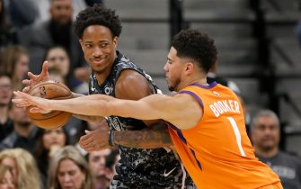 SAN ANTONIO, TX - JANUARY 24: DeMar DeRozan #10 of the San Antonio Spurs looks for room around Devin Booker #1 of the Phoenix Sunsduring an NBA game at the AT&T Center on January 24, 2020 in San Antonio, Texas. NOTE TO USER: User expressly acknowledges and agrees that, by downloading and or using this photograph, User is consenting to the terms and conditions of the Getty Images License Agreement.  (Photo by Edward A. Ornelas/Getty Images)