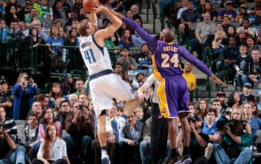 DALLAS, TX - NOVEMBER 13: Dirk Nowitzki #41 of the Dallas Mavericks shoots the ball against Kobe Bryant #24 of the Los Angeles Lakers during the game on November 13, 2015 at the American Airlines Center in Dallas, Texas. NOTE TO USER: User expressly acknowledges and agrees that, by downloading and or using this photograph, User is consenting to the terms and conditions of the Getty Images License Agreement. Mandatory Copyright Notice: Copyright 2015 NBAE (Photo by Danny Bollinger/NBAE via Getty Images)
