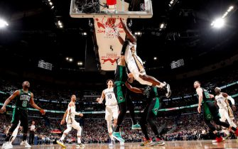 NEW ORLEANS, LA - JANUARY 26: Zion Williamson #1 of the New Orleans Pelicans dunks the ball during a game against the Boston Celtics on January 26, 2020 at Smoothie King Center in New Orleans, Louisiana. NOTE TO USER: User expressly acknowledges and agrees that, by downloading and or using this photograph, User is consenting to the terms and conditions of the Getty Images License Agreement. Mandatory Copyright Notice: Copyright 2020 NBAE (Photo by Jeff Haynes/NBAE via Getty Images)