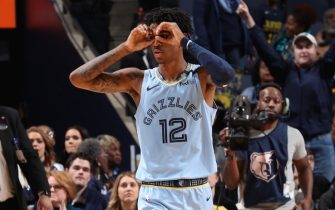 MEMPHIS, TN - JANUARY 26: Ja Morant #12 of the Memphis Grizzlies reacts to a play during the game against the Phoenix Suns on January 26, 2020 at FedExForum in Memphis, Tennessee. NOTE TO USER: User expressly acknowledges and agrees that, by downloading and or using this photograph, User is consenting to the terms and conditions of the Getty Images License Agreement. Mandatory Copyright Notice: Copyright 2020 NBAE (Photo by Joe Murphy/NBAE via Getty Images)