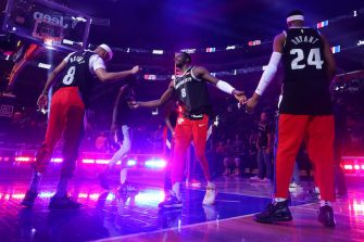 DETROIT, MICHIGAN - JANUARY 27: Reggie Jackson #1 of the Detroit Pistons and his teammates wear 8 and 24 jerseys during introductions to honor former Los Angeles Laker Kobe Bryant prior to playing the Cleveland Cavaliers at Little Caesars Arena on January 27, 2020 in Detroit, Michigan. NOTE TO USER: User expressly acknowledges and agrees that, by downloading and or using this photograph, User is consenting to the terms and conditions of the Getty Images License Agreement. (Photo by Gregory Shamus/Getty Images)