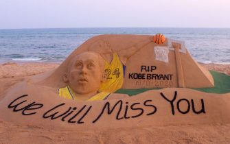 TOPSHOT - A sand sculpture by Indian artist Sudarsan Pattnaik, depicting American professional basketball player Kobe Bryant with the message 'we will miss you', is pictured at Puri beach, some 65 km away from Bhubaneswar on January 27, 2020. - Basketball legend Kobe Bryant's death in a helicopter crash along with his teenage daughter sparked an outpouring of grief across the worlds of sports and entertainment on January 27. (Photo by STR / AFP) (Photo by STR/AFP via Getty Images)