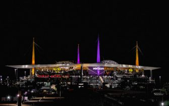 MIAMI, FLORIDA - JANUARY 27: A general view of Hard Rock Stadium lit up in purple and gold in memory of NBA star Kobe Bryant prior to Super Bowl LIV on January 27, 2020 in Miami, United States. (Photo by Mark Brown/Getty Images)