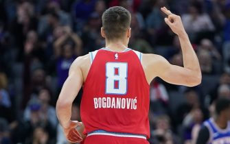 SACRAMENTO, CALIFORNIA - DECEMBER 13: Bogdan Bogdanovic #8 of the Sacramento Kings celebrates after making a three-point shot against the New York Knicks during the second half of an NBA basketball game at Golden 1 Center on December 13, 2019 in Sacramento, California. NOTE TO USER: User expressly acknowledges and agrees that, by downloading and or using this photograph, User is consenting to the terms and conditions of the Getty Images License Agreement. (Photo by Thearon W. Henderson/Getty Images)