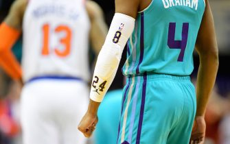 CHARLOTTE, NORTH CAROLINA - JANUARY 28: Devonte' Graham #4 of the Charlotte Hornets wears a #24 on his sleeve in honor of former NBA great Kobe Bryant during the first quarter during their game against the New York Knicks at Spectrum Center on January 28, 2020 in Charlotte, North Carolina. NOTE TO USER: User expressly acknowledges and agrees that, by downloading and/or using this photograph, user is consenting to the terms and conditions of the Getty Images License Agreement. (Photo by Jacob Kupferman/Getty Images)