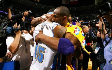 DENVER - MAY 29:  Kobe Bryant #24 of the Los Angeles Lakers hugs Carmelo Anthony #15 of the Denver Nuggets after Game Six of the Western Conference Finals during the 2009 NBA Playoffs at the Pepsi Center on May 29, 2009 in Denver, Colorado. NOTE TO USER: User expressly acknowledges and agrees that, by downloading and/or using this Photograph, user is consenting to the terms and conditions of the Getty Images License Agreement. Mandatory Copyright Notice: Copyright 2009 NBAE (Photo by Garrett W. Ellwood/NBAE via Getty Images)