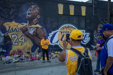 "LOS ANGELES, CA - JANUARY 28: Fans visit a mural of former NBA star Kobe Bryant who, along with his 13-year-old daughter Gianna, died January 26 in a helicopter crash, on January 28, 2020 in Los Angeles, California. Kobe and ""Gigi"" were among nine people killed in the crash in Calabasas, California as they were flying to his Mamba Sports Academy in Thousand Oaks, where he was going to coach her in a tournament game.  (Photo by David McNew/Getty Images)"