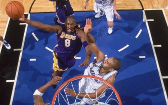 ORLANDO - NOVEMBER 12:  Kobe Bryant #8 of the Los Angeles Lakers moves for a dunk against Grant Hill #33 of the Orlando Magic at TD Waterhouse Centre on November 12, 2004 in Orlando, Florida. The Magic won 122-113.  NOTE TO USER: User expressly acknowledges and agrees that, by downloading and/or using this Photograph, user is consenting to the terms and conditions of the Getty Images License Agreement. Mandatory Copyright Notice: Copyright 2004 NBAE (Photo by: Fernando Medina/NBAE via Getty Images)