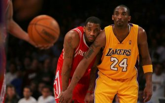 LOS ANGELES, CA - MARCH 30:  (L-R) Tracy McGrady #1  the Houston Rockets and Kobe Bryant #24 of the Los Angeles Lakers look on during a freethrow in the second half of the game at Staples Center on March 30, 2007 in Los Angeles, California.  NOTE TO USER: User expressly acknowledges and agrees that, by downloading and or using this Photograph, user is consenting to the terms and conditions of the Getty Images License Agreement.  (Photo by Lisa Blumenfeld/Getty Images)