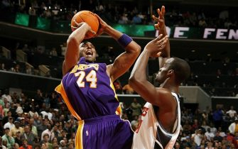 CHARLOTTE, NC - DECEMBER 29:  Kobe Bryant #24 of the Los Angeles Lakers shoots over Emeka Okafor #50 of the Charlotte Bobcats on December 29, 2006 at the Charlotte Bobcats Arena in Charlotte, North Carolina.  NOTE TO USER: User expressly acknowledges and agrees that, by downloading and or using this photograph, User is consenting to the terms and conditions of the Getty Images License Agreement.  Mandatory Copyright Notice:  Copyright 2006 NBAE (Photo by Kent Smith/NBAE via Getty Images)