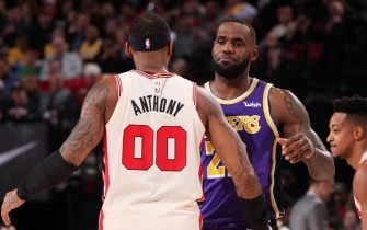 PORTLAND, OR - DECEMBER 28: Carmelo Anthony #00 of the Portland Trail Blazers and LeBron James #23 of the Los Angeles Lakers shake hands before the game on December 28, 2019 at the Moda Center Arena in Portland, Oregon. NOTE TO USER: User expressly acknowledges and agrees that, by downloading and or using this photograph, user is consenting to the terms and conditions of the Getty Images License Agreement. Mandatory Copyright Notice: Copyright 2019 NBAE (Photo by Cameron Browne/NBAE via Getty Images)