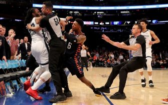 NEW YORK, NEW YORK - JANUARY 29:  The referees try to break up a fight between Jae Crowder #99 of the Memphis Grizzlies and Elfrid Payton #6 of the New York Knicks in the final minute of the game at Madison Square Garden on January 29, 2020 in New York City.The Memphis Grizzlies defeated the New York Knicks 127-106.NOTE TO USER: User expressly acknowledges and agrees that, by downloading and or using this photograph, User is consenting to the terms and conditions of the Getty Images License Agreement. (Photo by Elsa/Getty Images)
