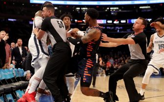 NEW YORK, NEW YORK - JANUARY 29:  The referees try to break up a fight between Jae Crowder #99 of the Memphis Grizzlies and Elfrid Payton #6 of the New York Knicks as the benches clear in the final minute of the game at Madison Square Garden on January 29, 2020 in New York City.The Memphis Grizzlies defeated the New York Knicks 127-106.NOTE TO USER: User expressly acknowledges and agrees that, by downloading and or using this photograph, User is consenting to the terms and conditions of the Getty Images License Agreement. (Photo by Elsa/Getty Images)