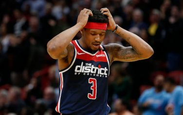 MIAMI, FLORIDA - JANUARY 22:  Bradley Beal #3 of the Washington Wizards reacts after missing a three pointer against the Miami Heat in the closing seconds of overtime at American Airlines Arena on January 22, 2020 in Miami, Florida. NOTE TO USER: User expressly acknowledges and agrees that, by downloading and/or using this photograph, user is consenting to the terms and conditions of the Getty Images License Agreement.  (Photo by Michael Reaves/Getty Images)