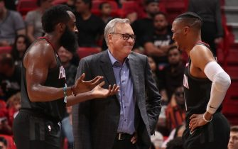 MIAMI, FL - OCTOBER 18: Head Coach Mike D'Antoni of the Houston Rockets, James Harden #13, and Russell Westbrook #0 of the Houston Rockets smile during a pre-season game against the Miami Heat on October 18, 2019 at American Airlines Arena in Miami, Florida. NOTE TO USER: User expressly acknowledges and agrees that, by downloading and or using this Photograph, user is consenting to the terms and conditions of the Getty Images License Agreement. Mandatory Copyright Notice: Copyright 2019 NBAE (Photo by Issac Baldizon/NBAE via Getty Images)
