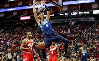 HOUSTON, TEXAS - JANUARY 31: Kristaps Porzingis #6 of the Dallas Mavericks dunks the ball in front of P.J. Tucker #17 of the Houston Rockets in the fourth quarter at Toyota Center on January 31, 2020 in Houston, Texas.  NOTE TO USER: User expressly acknowledges and agrees that, by downloading and or using this photograph, User is consenting to the terms and conditions of the Getty Images License Agreement. (Photo by Tim Warner/Getty Images)