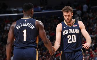 MEMPHIS, TN - JANUARY 31: Zion Williamson #1 and Nicolo Melli #20 of the New Orleans Pelicans hi-five during the game against the Memphis Grizzlies on January 31, 2020 at FedExForum in Memphis, Tennessee. NOTE TO USER: User expressly acknowledges and agrees that, by downloading and or using this photograph, User is consenting to the terms and conditions of the Getty Images License Agreement. Mandatory Copyright Notice: Copyright 2020 NBAE (Photo by Joe Murphy/NBAE via Getty Images)