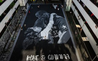 TOPSHOT - A large drawing shows US NBA basketball legend Kobe Bryant and daughter Gianna at a basketball court in Taguig, south of Manila on January 29 2020. - Nine people were killed in the helicopter crash that claimed the life of NBA star Kobe Bryant and his 13-year-old daughter, Los Angeles officials confirmed on January 26, 2020. (Photo by Maria TAN / AFP) (Photo by MARIA TAN/AFP via Getty Images)