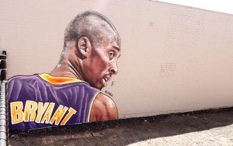 """MELBOURNE, AUSTRALIA - JANUARY 30: A mural painted by Australian street artist Lush Sux is seen on Budd Street, Collingwood on January 30, 2020 in Melbourne, Australia. Former NBA great Kobe Bryant died along with his 13-year-old daughter Gianna in a helicopter crash on January 28, 2020 in Los Angeles, California. Kobe and """"Gigi"""" were among nine people killed in the crash in Calabasas, California as they were flying to his Mamba Sports Academy in Thousand Oaks, where he was going to coach her in a tournament game. (Photo by Darrian Traynor/Getty Images)"""