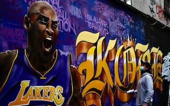 A Dutch graffiti artist Fleks looks at his painting in memories of NBA basketball legend Kobe Bryant at the Taipei Cinema Park on February 1, 2020. (Photo by Sam Yeh / AFP) (Photo by SAM YEH/AFP via Getty Images)