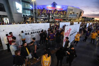 LOS ANGELES, CA - JANUARY 31: Fans honor Kobe Bryant outside of Staples Center before the game between the Los Angeles Lakers and the Portland Trail Blazers on January 31, 2020 at STAPLES Center in Los Angeles, California. NOTE TO USER: User expressly acknowledges and agrees that, by downloading and/or using this Photograph, user is consenting to the terms and conditions of the Getty Images License Agreement. Mandatory Copyright Notice: Copyright 2020 NBAE (Photo by Juan Ocampo/NBAE via Getty Images)