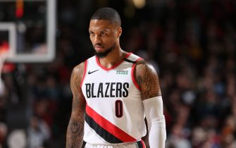 PORTLAND, OR - FEBRUARY 1: Damian Lillard #0 of the Portland Trail Blazers looks on during a game against the Utah Jazz on February 01, 2020 at the Moda Center Arena in Portland, Oregon. NOTE TO USER: User expressly acknowledges and agrees that, by downloading and or using this photograph, user is consenting to the terms and conditions of the Getty Images License Agreement. Mandatory Copyright Notice: Copyright 2020 NBAE (Photo by Sam Forencich/NBAE via Getty Images)